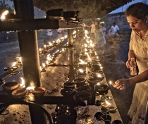 Candle offerings at the Temple of the Tooth, Kandy, evening 'Vesak' full moon puja for the Buddha's birthday