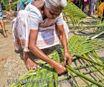 Lokumenike - competing in a womens' coconut leaf weaving contest (don't ask..!) she came last ...