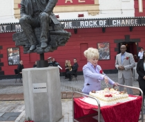 Barbara cutting the birthday cake for Joan Littlewood