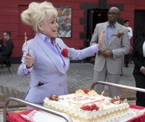 Barbara Windsor leading the singing of 'Happy Birthday' to Joan