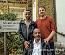 Tesfay (L) with his father Samuel (seated) and their solicitor Daniel Rourke