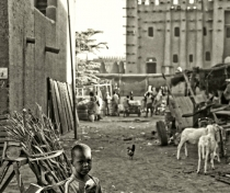 Small boy with Great Mosque of Djenné in the background