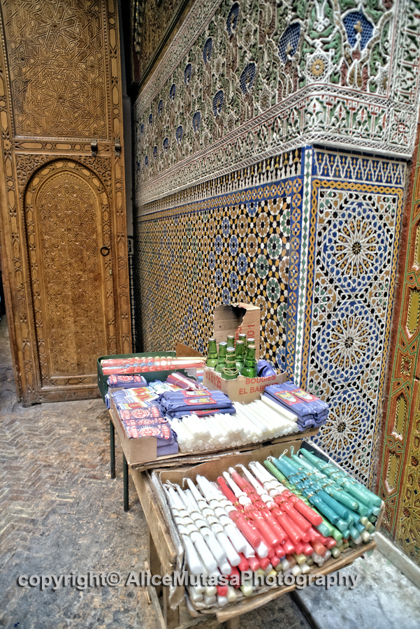 Votive candles on sale at entrance to Mausolée Moulay Hassan