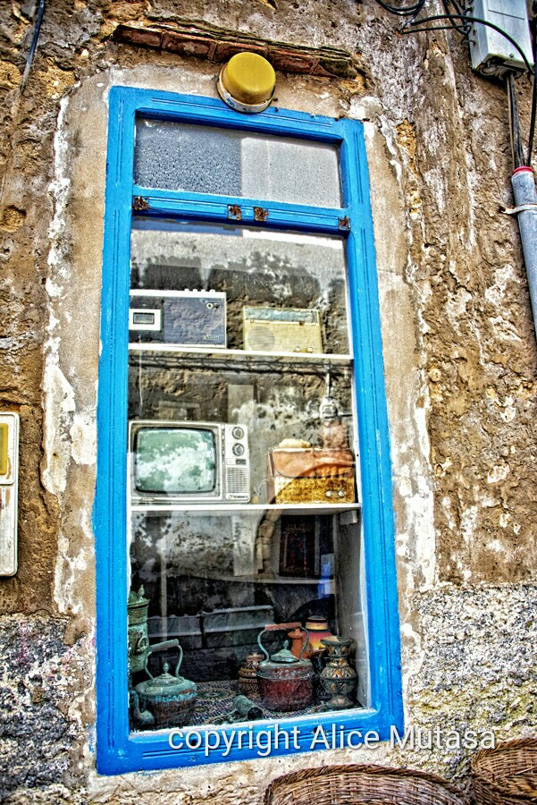 Mis-matched objects in a shop window inEssaouira
