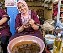 This is Rackiya - making argan oil outside the Bio Argan shop in the medina