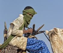 Young Touareg on his camel