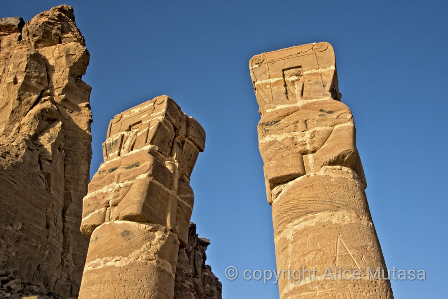 Faces carved into the pillars at the Temple of Amun, near Karima