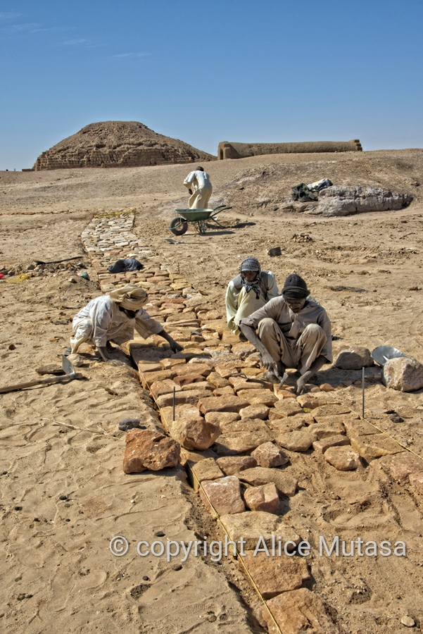 Workmen building a path at El Kurru