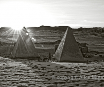 Sunrise with workman - restored pyramids at Meroë