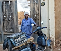 Moussa with his vespa; Omdurman