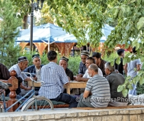 Local life; men playing a board game by the Labi Hauz pool, Bukhara