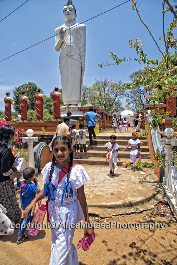 Schoolchildren coming from their Sunday class at a temple near Sighiriya