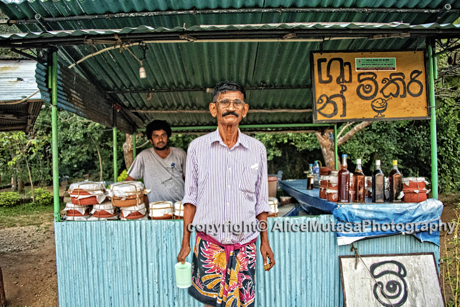 I didn't manage to get his name; I think he is the owner of this roadside bar selling 'curd' - delicious home-made yoghourt