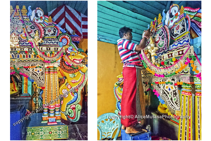 Decorating a lovely small roadside Hindu temple for the Choti Holi festival
