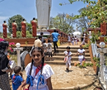 Schoolchildren coming from their Sunday class at a temple near Sighiriya