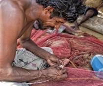 Perevan - mmending fishing nets, near Dolphin Beach Kalpitya