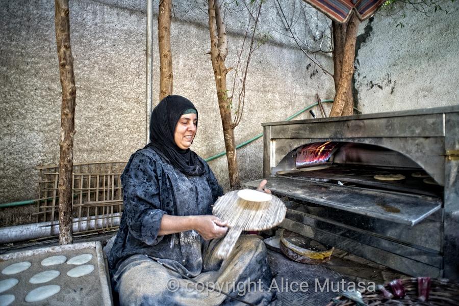 Raga making bread at Blueberry restaurant, near Saqqara