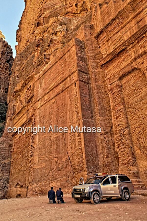Two policemen praying in Petra