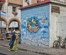 Street art and orange sellers near Bab Doukalla