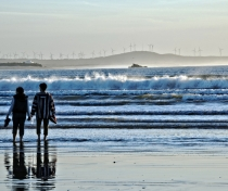 Couple in sea at dusk