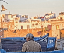 Old fisherman at dusk