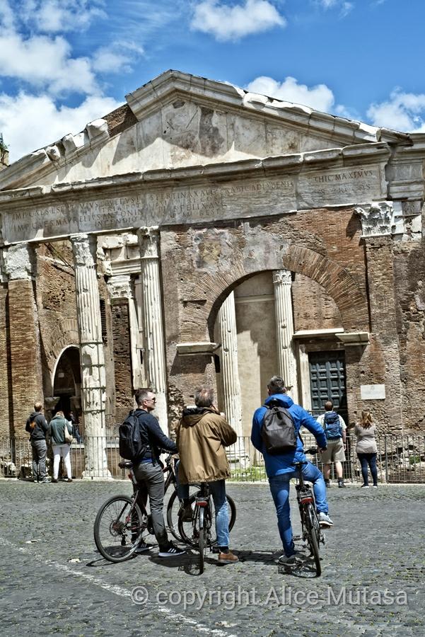 Cyclists at Portico d'Otavia