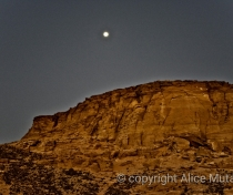 Almost full moon above the sacred mountain of Jebel Barkal