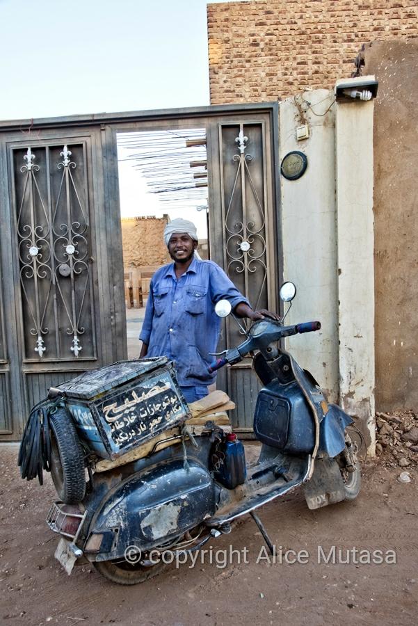 Moussa with his vespa; Omdurman