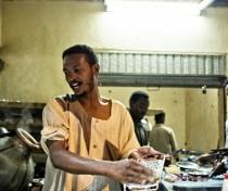 Soufiane preparing ful; Karima