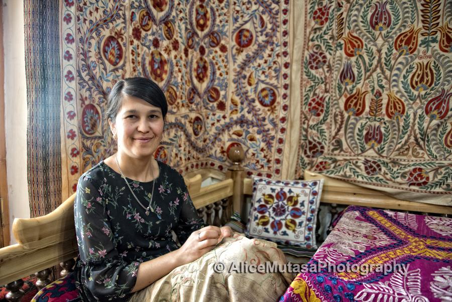 Feruza, wife of Gulom Isaev embroidering suzani