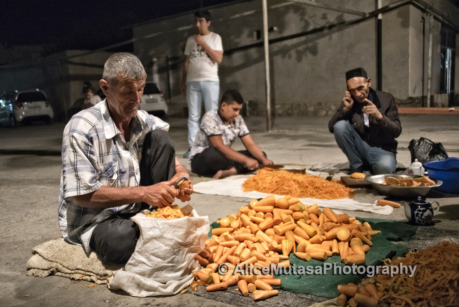 Making the national dish 'plov' in our local square, Bukhara