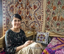 Feruza, wife of Gulom Isaev embroidering suzani