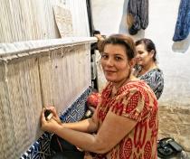 Nargiza weaving a silk carpet